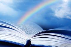 Biblia con el arco iris Foto de archivo libre de regalías