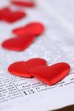 Biblia y corazones Fotos de archivo