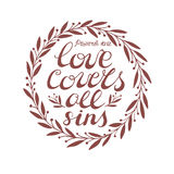 Biblical background with hand lettering Love covers all sins. Hand lettering Love covers all sins, done in a circle with leaves. Biblical background. Christian Royalty Free Stock Photo