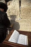 Book of Psalms at the Wailing Wall. The biblical Book of Psalms opened on one of the pages of the morning prayer, resting on a pedistal . There's also a Jewish Royalty Free Stock Photography