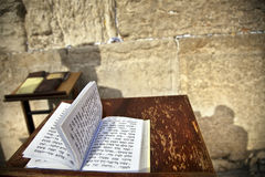 Book of Psalms at the Wailing Wall. The biblical Book of Psalms opened on one of the pages of the morning prayer, resting on a pedistal . There's also a shadow Stock Photos