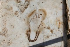 Biblical Ephesus. This footprint engraved in a road in Ancient Ephesus is believed to be an advertisement to a nearby brothel. If so, this may be the oldest royalty free stock photo