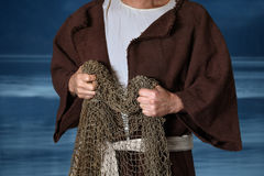 Biblical Fisherman Holding Nets. With lake in background royalty free stock photo