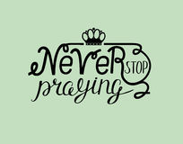 Biblical lettering Never stop praying with crown. Stock Image