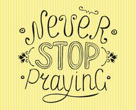 Biblical lettering Never stop praying. Stock Photo
