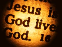Biblical message - close up. A macro look at a New Testament biblical passage focusing on the words Jesus and God forming the central message of Christianity Royalty Free Stock Photography
