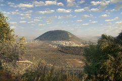 Biblical Mount Tavor and the Arab village Stock Photos