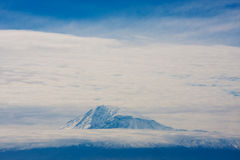 Biblical Mt. Ararat. Surrounded with fluffy Clouds Stock Photos