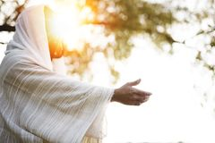 Free Biblical Scene - Of Jesus Christ Landing A Hand For Help With The Sun Shining Near His Face Royalty Free Stock Photo - 161826855
