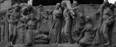 Biblical scene. Shot in black and white. Placed on the facade of this historic building, sculpture representing a biblical scene. Set in Eixample, Barcelona Stock Photo