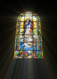 Biblical stained glass. With rays of light shining through Royalty Free Stock Images