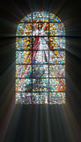 Biblical stained glass. With rays of light shining through Royalty Free Stock Image