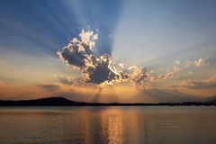 Biblical  sunset cloudscape. Biblical cloudscape with sunset light . Lake water reflection Royalty Free Stock Images