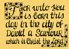 Biblical text, highlighting the capital letter Now was born in the city of David a Saviour, which is Christ the Lord. Royalty Free Stock Image