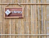 Biblioteczny znak na bambusowym tle Obraz Royalty Free