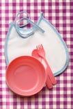 Bibs, шар и ложка для младенца Стоковое Изображение RF