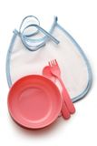 Bibs, bowl and spoon Stock Photos