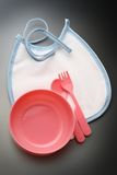 Bibs, bowl and spoon for baby Stock Images