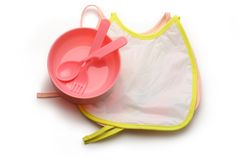 Bibs and spoon for baby Stock Images
