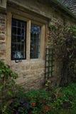 Bibury stone cottage window garden Stock Photos