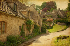 Bibury. Traditional Cotswold cottages after the rain Royalty Free Stock Images