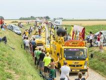 BIC Caravan on a Cobblestone Road- Tour de France 2015 Stock Photos