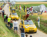 BIC Caravan on a Cobblestone Road- Tour de France 2015. Quievy,France - July 07, 2015: BIC caravan during the passing of the Publicity Caravan on a cobblestone royalty free stock photos