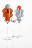 Bicchiere di vino con le palle da golf Fotografia Stock Libera da Diritti