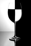 Bicchiere di vino con liquido Fotografia Stock
