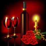 Bicchiere di vino nel lume di candela Fotografia Stock