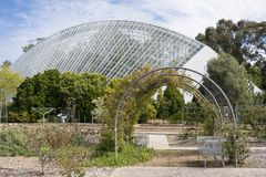 Bicentennial Conservatory and Rose Garden, Adelaide Botanic Gard. Adelaide, South Australia, Australia - September 10, 2017: Bicentennial Conservatory at the Stock Photos