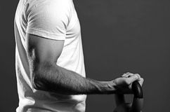 Bicep Curl. Black and white image of a man performing a bicep curl Royalty Free Stock Photo