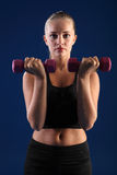 Bicep curl anaerobic exercise young fitness woman Stock Photos