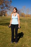 Bicep curls. Young woman perfoming bicep curls Royalty Free Stock Photo