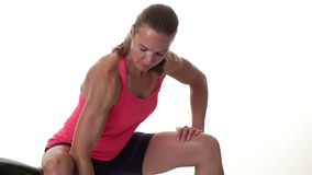 Bicep Curls. Woman performing bicep curl exercise. Studio shot over white stock video