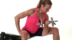 Bicep Curls. Woman performing bicep curl exercise. Studio shot over white stock video footage