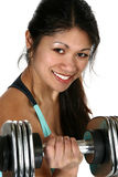 Bicep Dumbbell Curl. Beautiful Filipino woman doing bicep curl with free weights Royalty Free Stock Image