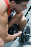 Bicep Rotation - seitlicher Schuß stockfoto
