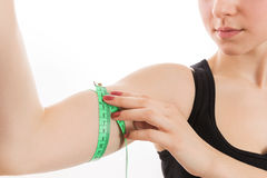 Bicep with tape measure Royalty Free Stock Image