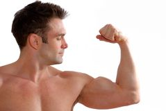 Biceps. Man flexing his biceps to show off his strength stock images