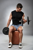Biceps curl in seated position Stock Images