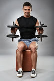 Biceps curl in seated position Stock Photo