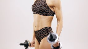 Biceps curls with dumbbells stock footage
