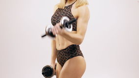 Biceps curls with dumbbells stock video footage