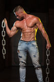 Biceps Exercise With Chains. Healthy Young Man Exercising Biceps With Chains royalty free stock photo