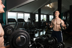 Biceps Exercise In Front Of A Mirror Stock Photos