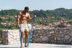 Biceps Exercise Using Resistance Bands Royalty Free Stock Photo