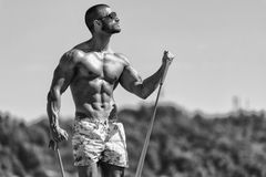 Biceps Exercise Using Resistance Bands Stock Images