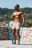 Biceps Exercise Using Resistance Bands Royalty Free Stock Photography