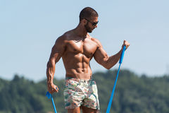 Biceps Exercise Using Resistance Bands Royalty Free Stock Photos